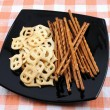 Crackers and salty sticks to beer — Stock Photo