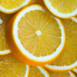 Background the juicy orange cut by round - Stock Photo