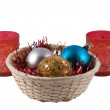 Basket with fur-tree spheres and two can — Stock Photo