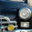 The right headlight of old automobile - Stock Photo