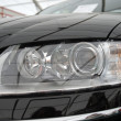 The right headlight of modern automobile - Stock Photo