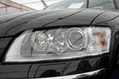 The right headlight of modern automobile — Stock Photo