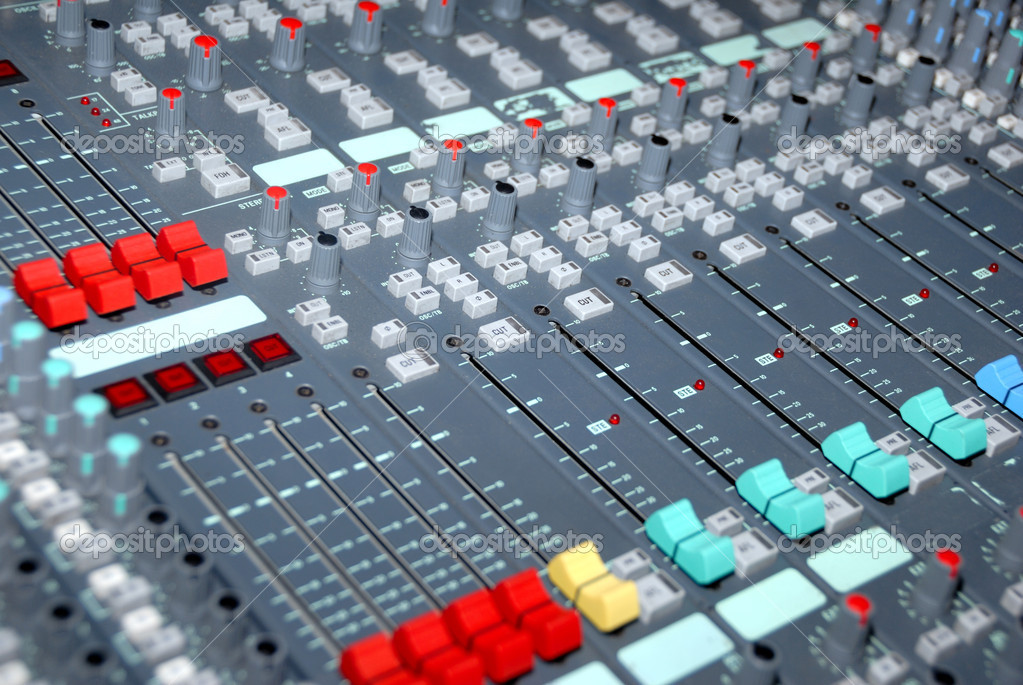 Audio mixing console in a recording studio. Faders and knobs of a sound mixer.  Stock Photo #1844733