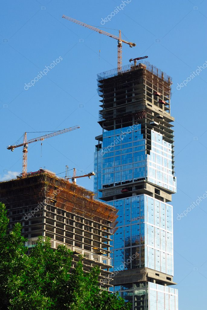 Construction of skyscrapers from glass, a steel and concrete of a complex of the international business centre — Stock Photo #1846554