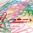 colored paper clips on white — Stock Photo