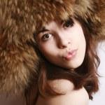 Girl in a fur cap — Stock Photo #1237340