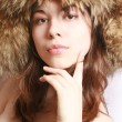 Girl in a fur cap — Stock Photo