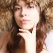 Girl in a fur cap — Stock Photo #1237875