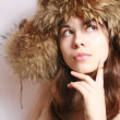 Girl in a fur cap — 图库照片