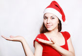 Girl in the christmas cap — Stock Photo
