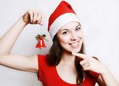 Girl in a christmas cap — Stock Photo