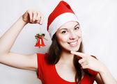 Girl in a christmas cap — Stock Photo
