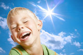 The boy, the sun and the sky. — Stock Photo
