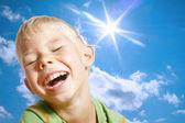 The boy, the sun and the sky. — Stock Photo