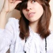 Royalty-Free Stock Photo: The girl in a felt hat.