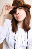 The girl in a felt hat. — Stock Photo