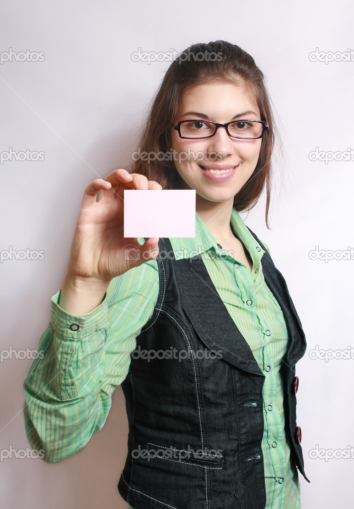 The girl holds a card in the hand extended forward.  Stock Photo #1526865