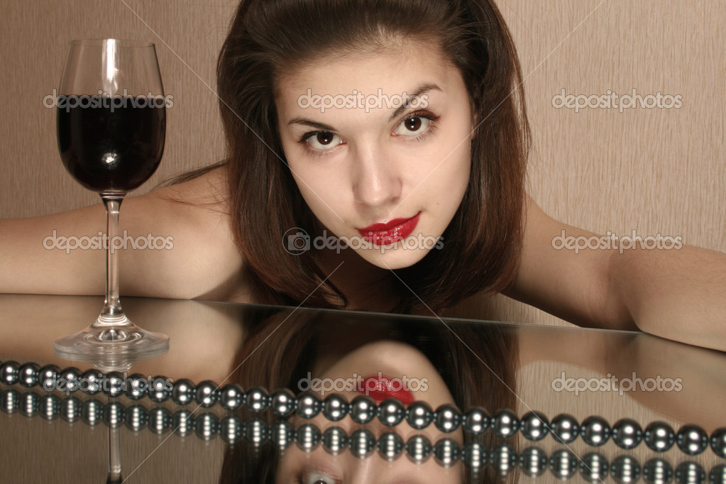 Portrait of the girl with a glass of wine and reflection in a mirror.  Stock Photo #1535490