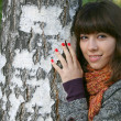 The girl at a tree. — Fotografia Stock  #1544368