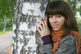 The girl at a tree. — Stock Photo