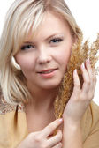 Girl with wheat spike — Stok fotoğraf