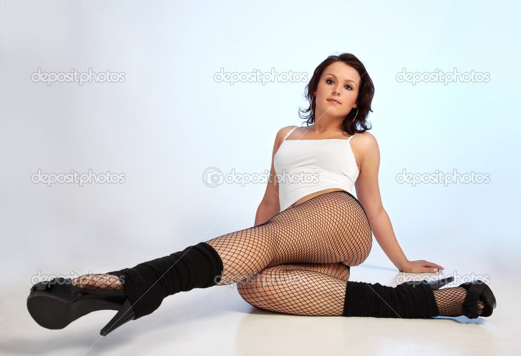 Portrait of beautiful slavonic model girl posing in white top and fishnets — Stock Photo #1215108