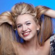 Beautiful blonde touching hair — Stock Photo