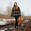 Girl on railroad - Stock Photo