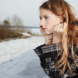 Girl near winter river — Stock Photo