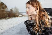 Girl near winter river — Stock Photo