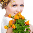 Girl with bouquet of flowers — Stock Photo