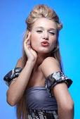 Beautiful blonde blowing kiss — Stock Photo