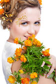Girl with bouquet of flowers — Stockfoto