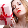 Girl with present — Stock Photo #1294300