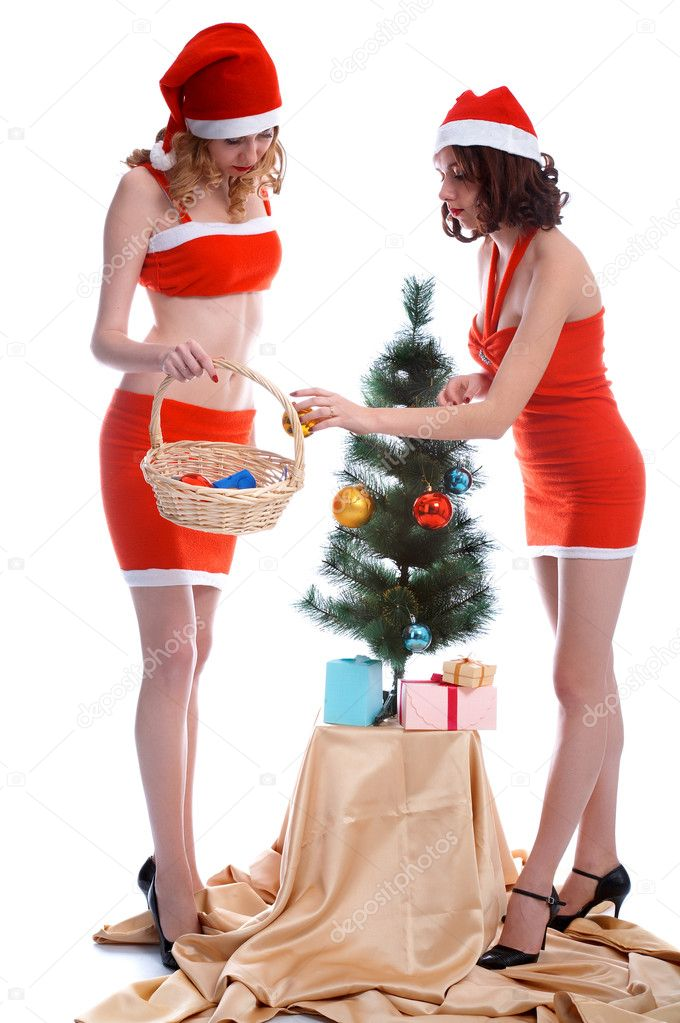 Girls in fancy dress decorating Christmas tree  Stock Photo #1293716