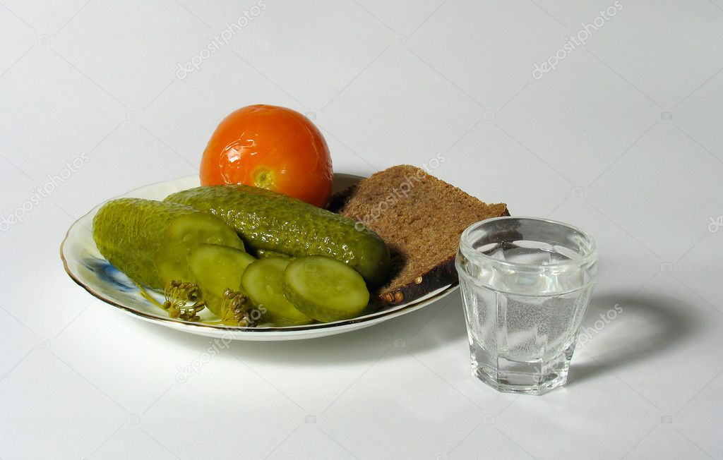 Plate with cucumbers and tomato and vodka — Stock Photo #1299928