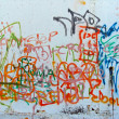 Graffiti sprayed on a wall - Stok fotoğraf