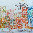 Graffiti sprayed on a wall - Stock Photo