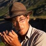 Man smoking tobacco-pipe — Stock Photo #1301680