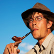 Man smoking tobacco-pipe — Stock Photo
