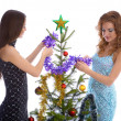New year tree triming — Stock Photo #1308293
