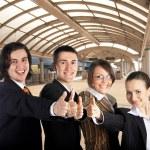 Businessteam on railway station — Stock Photo