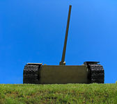 Old russian tank on the green grass — Stock Photo
