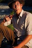 Man smoking tobacco-pipe — Stock Photo