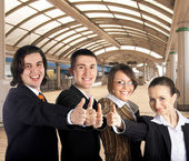 Businessteam on railway station — Stock Photo