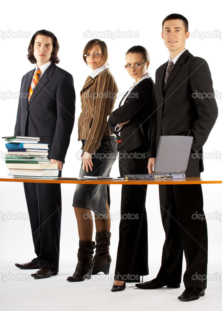 Business team with laptop and books near the table  Stock Photo #1309526