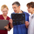 Two doctors and nurse — Stock Photo