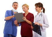 Two doctors and nurse — Stockfoto