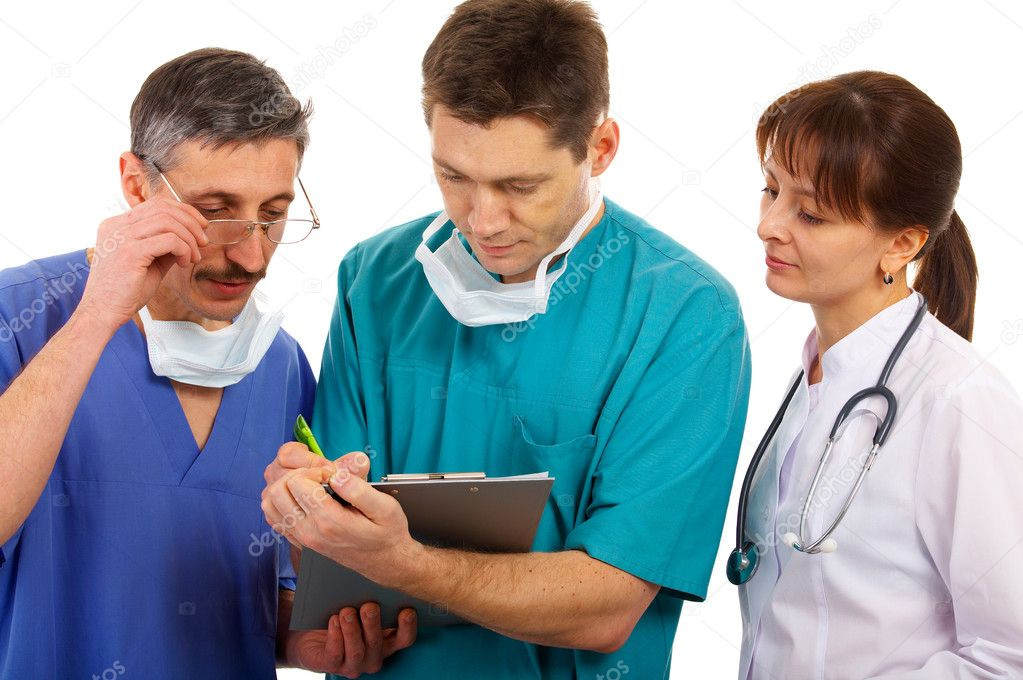 Female and male doctors with schedule — Stock Photo #1310685