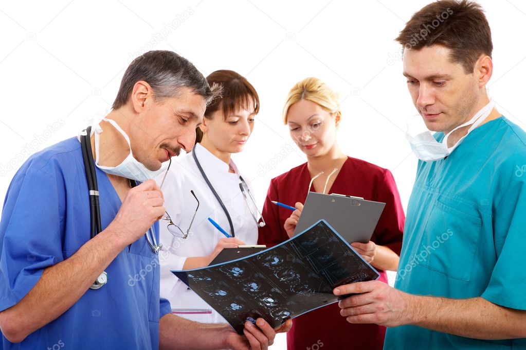 Nurse, two male and one female doctors with schedule and accessories — Stock Photo #1310705